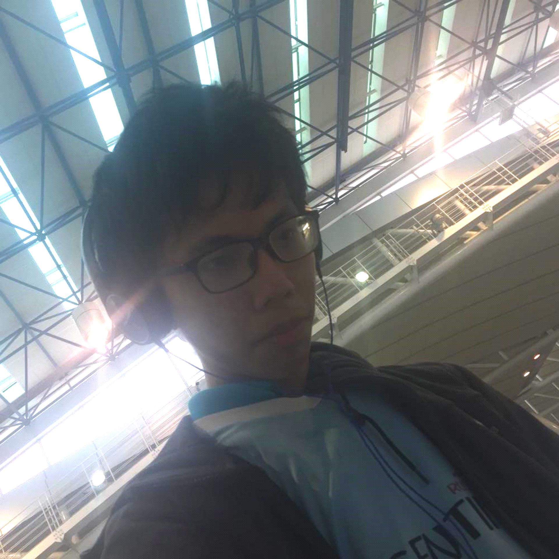 Tan Zing Fung looking down at camera